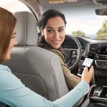 Mom and Daughter using Honda Pilot Technology