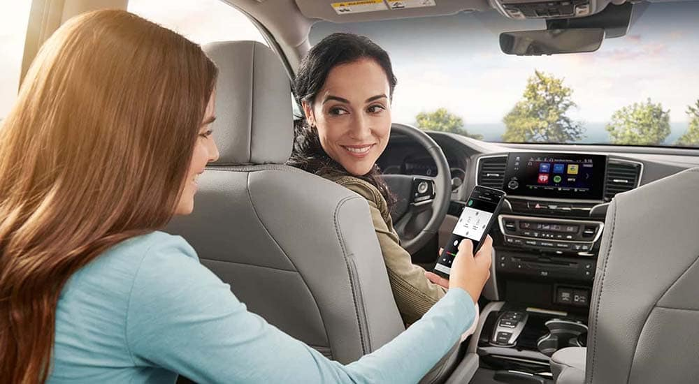 Mom and Daughter using Honda Pilot Technology