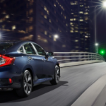 2020 honda civic blue exterior driving down road at night