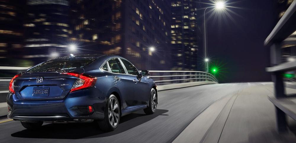 2020 honda civic blue exterior driving down road at night