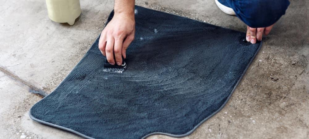 cleaning car floor mats