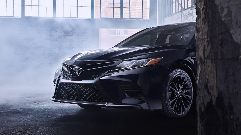 2019 Toyota Camry black coming around corner