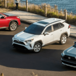 2020 Toyota RAV4 in blue, red, and white near beachside