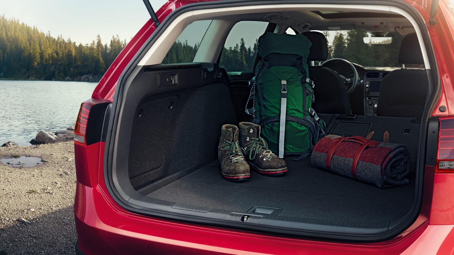Camping gear in a red 2019 VW Golf Alltrack
