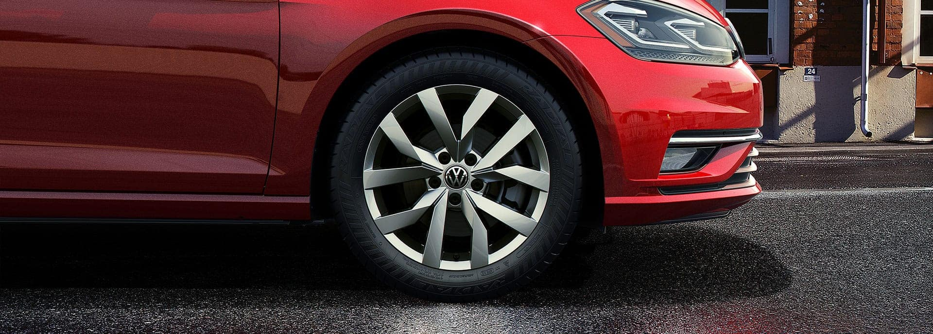 A close-up of the wheel on a red 2019 VW Golf