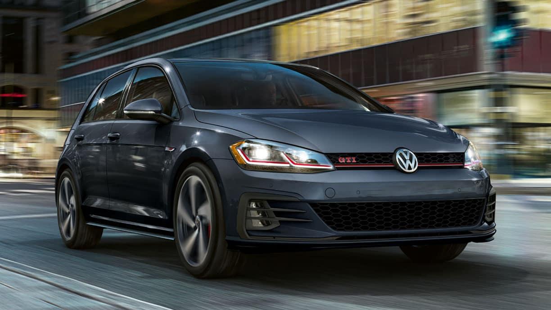 2019 VW Golf GTI driving through a city.