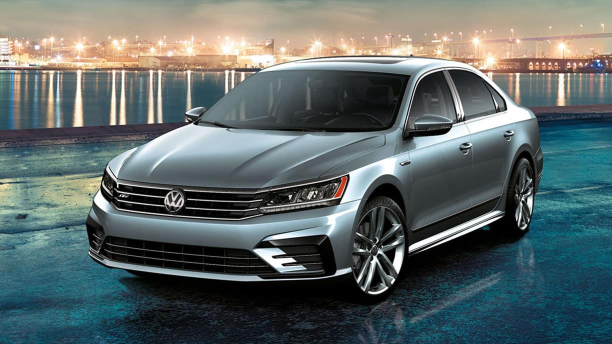 2019 VW Passat parked by the waterfront at night.