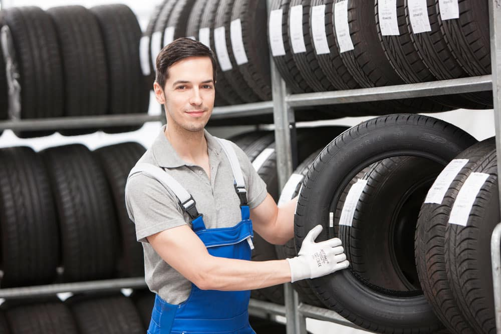 Volkswagen technician with tires